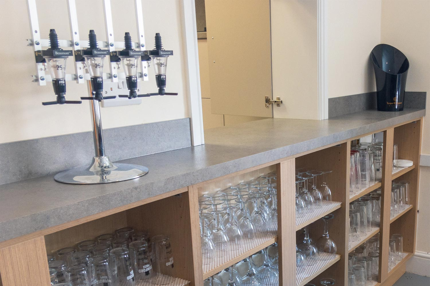 View of bar area with optic stand and access hatch to kitchen