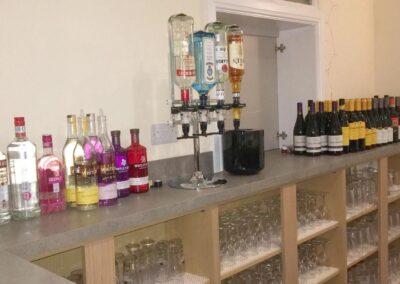 Dumbleton Village Hall bar area with stock